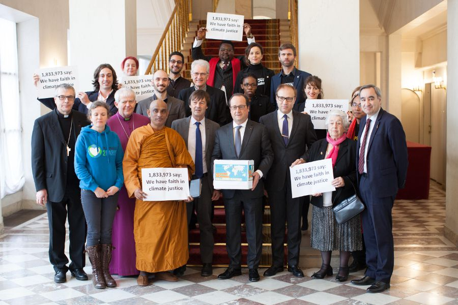 Faith leaders and campaigners deliver a climate justice petition to Francois Hollande at the Presidential palace in Paris - credit Sean Hawkey